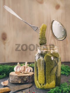 Pickled cucumbers on wooden background Pickled cucumbers on wooden background