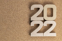 Year 2022 in cardboard figures on a cork background