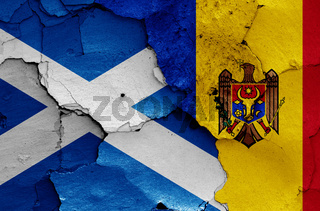 flags of Scotland and Moldova painted on cracked wall