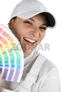 Decorator holding paint color charts