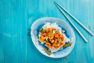 Shirataki (konjak) noodle with shrimps and curry  sauce and vegetables. Dietary
