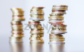 Money concept: Coins tacked on each other. Inflation, currency, savings, money