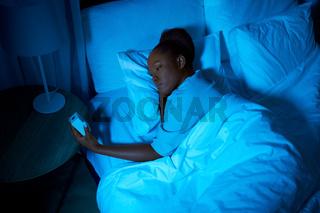 woman awaking because of alarm clock at night