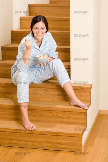 Home breakfast happy woman pajamas eating cereals