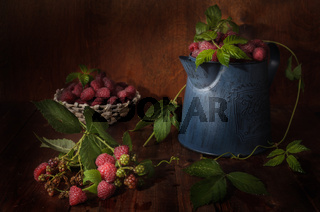 ripe raspberries on a dark wooden background in a rustic style