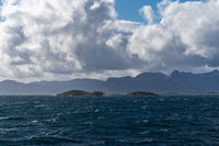 The Atlantic Ocean with Hjertholmen Island and the Lofoten Islands of northern Norway