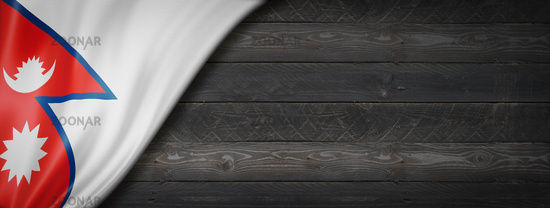 Nepalese flag on black wood wall banner