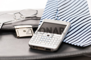 Business mens' accessories tie briefcase phone
