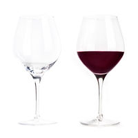 Red wine glass, empty and full, isolated on a white background