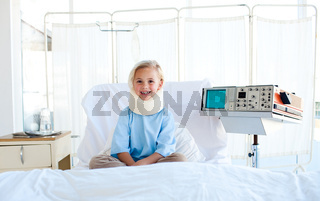 A patient with a neck brace sitting on a hospital bed