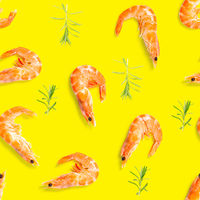 Tiger shrimp. Seamless pattern made from Prawn isolated on a yellow background. Seafood seamless pattern with shrimps. seafood pattern