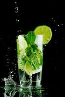 Pouring mojito cocktail