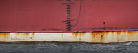 Exterior of a red ship hull