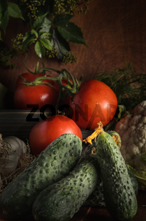 ripe vegetables on a dark wooden background in a rustic style