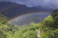 Tahiti. Polynesia. Clouds over a mountain landscape and rainbow