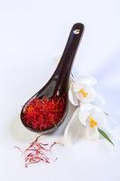 Saffron threads and white crocus flowers.