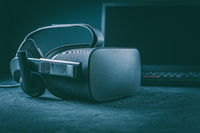 VR headset - virtual reality glasses for simulation of reality for different multimedia with laptop in background