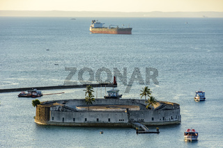 Fortress surrounded by the waters of the Salvador sea at dusk