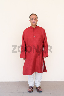 Full length ortrait of Indian man wearing traditional clothes