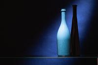 Blue and black empty wine bottles.