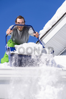 Manually removing fresh snow from a roof