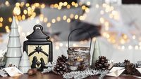 Various home Christmas or New Year decorations composition at coffee table