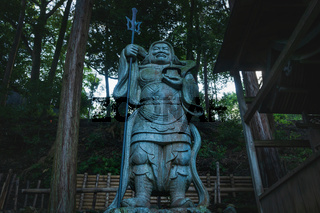 Samurai statue from low angle view at Mikami-jinja Shrine in Kyoto, Japan