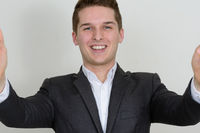 Portrait of happy young handsome businessman in suit