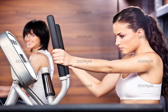 Women in gym center