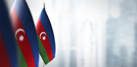 Small flags of Azerbaijan on a blurry background of the city