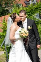 bride kiss man wedding