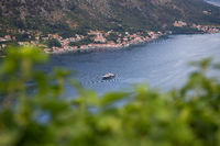 Incredibly beautiful view of the Bay of Kotor along which the yacht sails on a beautiful summer day in Montenegro. Very beautiful view of the fjord from above.