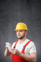 Portrait of a worker using his smartphone