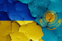 flags of Ukraine and Kazakhstan painted on cracked wall