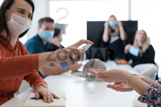 new normal businesspeople on meeting using antibacterial hand sanitizer