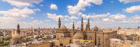 Panoramic shot of minarets and domes of Sultan Hasan Mosque and Al Rifai Mosque in Cairo, Egypt