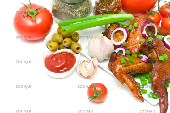 delicious smoked chicken wings with vegetables on a white background