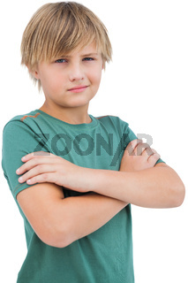 Blonde boy with arms crossed