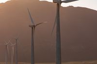General view of wind turbines in countryside landscape