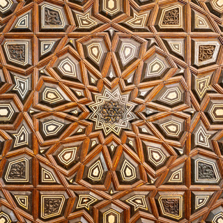 Wooden arabesque decorations, inlaid with ivory and ebony, on old aged door, Cairo, Egypt