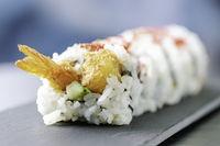 sushi tempura shrimp roll on slate