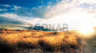 Sunset landscape.Fields and hill