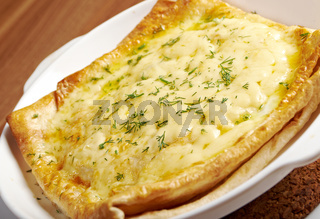 Qutab -baked  lavash cheese pie