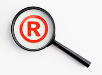 magnifying glass with registered trademark
