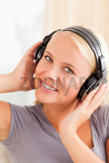Portrait of a smiling woman listening to music