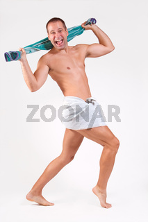 Man with towel on white background