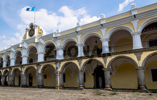 'Palacio de los Capitanes Generales' - Palace of the Captains General with country flag in Antigua, Guatemala.