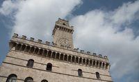 Pulcinella clock tower building at piazza Grande in montepulciano , Tuscany italy