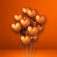 Copper heart shape balloons bunch on orange wall background