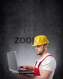 Construction worker with a laptop